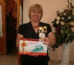 Руководитель танцевального коллектива Движение Кожанова Анна Михайловна с наградами