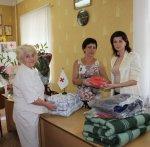 Жильцы квартиры, пострадавшей от взрыва товарного поезда на станции Белая Калитва, получили гуманитарную помощь