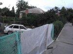 Автомобиль ВАЗ -  211440 превысил скорость, врезался в столб и выломал забор частного дома