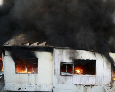 В Ростове в Донецком переулке горел частный дом, пострадала женщина