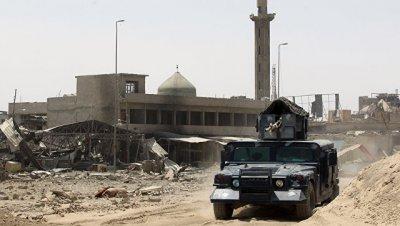В Ираке военные нашли массовое захоронение жертв ИГ* на юге Рамади