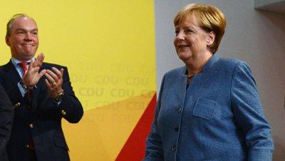 Партия Меркель выиграла выборы в бундестаг