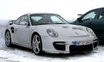 Porsche 911 GT2 2008 снимает камуфляж